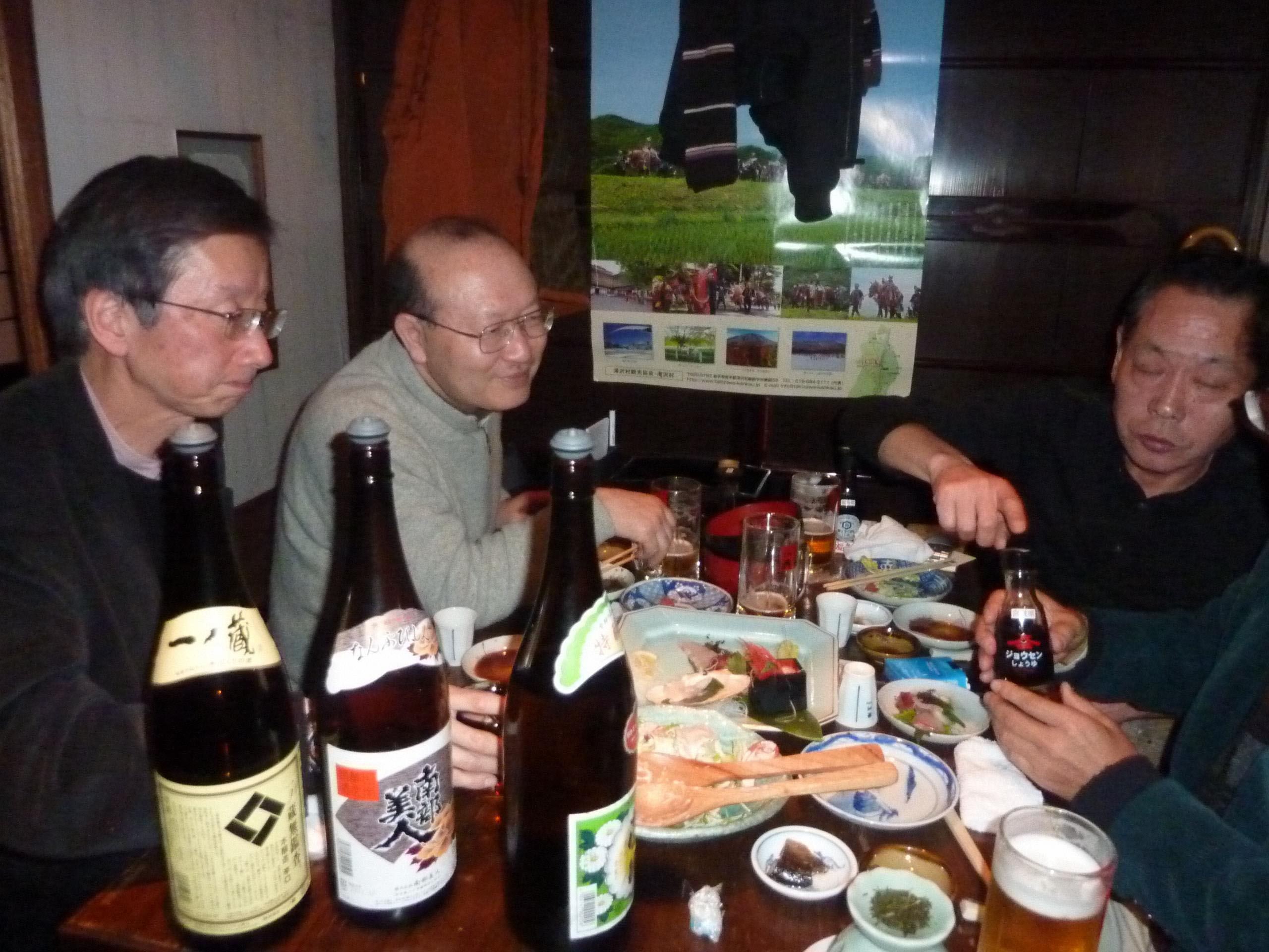 Tastes good, feels good: Customers sample dishes and sake from Iwate, Miyagi and Fukushima prefectures at the Reconstruction Support Tavern in Tokyo on Feb. 14. The eatery will donate all its profits through September to rebuilding work in Tohoku. | KYODO PHOTOS