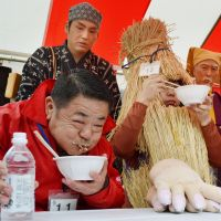Stuffing his face: A competitor grimaces as he tries to bolt down 'natto' fermented beans during  a speed-eating contest in Mito, Ibaraki Prefecture, on Saturday.   KYODO