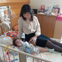 Maternal: Lawmaker Seiko Noda of the Liberal Democratic Party spends time with her son Masaki in a hospital. | SEIKO NODA'S OFFICE / KYODO