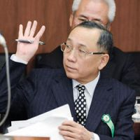 Facing the music: AIJ Investment Co. President Kazuhiko Asakawa appears Tuesday before the Lower House Financial Affairs Committee. | KYODO