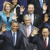 Happy family: Prime Minister Yoshihiko Noda (second from right in back row) waves during a photo session with other world leaders at the Nuclear Security Summit in Seoul on Tuesday. | AP