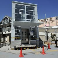 An elevator at Urayasu Station that was cordoned off last April (below) resumes operations March 21.