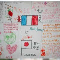 The good fight: The children behind Fight Shimbun, an illustrated handwritten wall newspaper, gave this special edition to Institution Jeanne d'Arc, a school near Paris. | KYODO