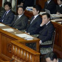 Apprehensive: Prime Minister Yoshihiko Noda watches the budget vote in the Upper House on Thursday. | KYODO
