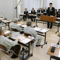 If you build it, they won't come: Environment Minister Goshi Hosono addresses officials from Naraha, Fukushima Prefecture, on Saturday in the town of Iwaki over the central government's plan to build a storage facility for irradiated soil. | KYODO