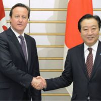 Arms deal: British leader David Cameron is greeted by Prime Minister Yoshihiko Noda before holding talks at the prime minister's office Tuesday. | KYODO
