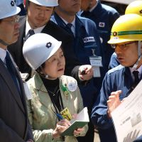 Concerned neighbors: Shiga Gov. Yukiko Kada (center) and Kyoto Gov. Keiji Yamada (left) listen to a Kansai Electric Power Co. official while inspecting the Oi nuclear power plant in Oi, Fukui Prefecture, on Thursday. | KYODO