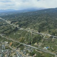 New and improved: A section of the new Tomei Expressway (top), which will connect Tokyo and Nagoya when it opens fully in fiscal 2020, is seen running parallel to the existing Tomei Expressway (center) in Numazu, Shizuoka Prefecture, on April 7. | KYODO