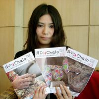 Trailblazer: Chalo Editor-in-Chief Harumi Shinsha holds copies of the free monthly magazine in New Delhi on April 3. | KYODO