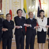 Save me a river: Cambodian Prime Minister Hun Sen (far left), Laotian Prime Minister Thongsing Thammavong, Prime Minister Yoshihiko Noda, Myanmar President Thein Sein, Thai Prime Minister Yingluck Shinawatra and Vietnamese Prime Minister Nguyen Tan Dung pose for a group photo before the Mekong-Japan Summit held in Tokyo on Saturday. | AP