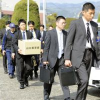 Evidence gathering: Yamaguchi police on Monday enter the Mitsui Chemicals Inc. plant in Waki the day after explosions there killed one worker and injured 22.   KYODO