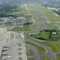 Ready for takeoff: Narita airport's contested second runway (top right), which marked its 10th anniversary on Wednesday, is shown in October 2011. | KYODO
