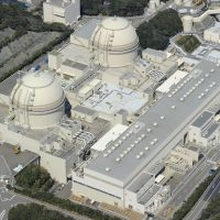 Overall view: Buildings housing reactors 3 and 4 at the Oi nuclear plant in Fukui Prefecture are seen in this March photo. | KYODO