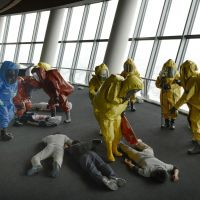 Just in case: Police, firefighters and local residents take part in a counterterrorism drill on the observation deck of Tokyo Sky Tree in Sumida Ward on Monday.   KYODO
