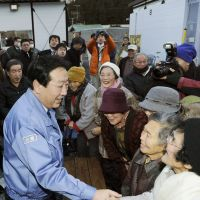 Checking up: Prime Minister Yoshihiko Noda greets elderly residents at a temporary housing facility in Ofunato, Iwate Prefecture, in January. | KYODO
