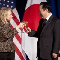 Your good health: U.S. Secretary of State Hillary Rodham Clinton toasts Prime Minister Yoshihiko Noda during a dinner Monday at the National Geographic Society in Washington. | AP