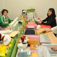 Righting wrongs: Naomi Sakurai (top left) and three of her staff take a break at Cansol's offices in Tokyo on April 23.   YOSHIAKI MIURA