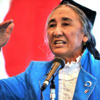 In the open: Exiled Uighur leader Rebiya Kader delivers the opening speech Monday at the 4th World Uyghur Congress in Tokyo.   AFP-JIJI