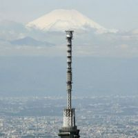 Size matters: Tokyo Skytree towers above the capital on Wednesday, a day after the world's tallest freestanding structure opened to the public, with Mount Fuji in the distance. | KYODO