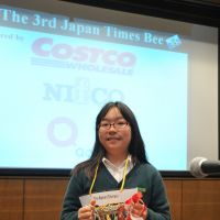 Bee best: Haruka Masuda holds the champion's cup after winning The Japan Times Spelling Bee in Tokyo on March 101. | YOSHIAKI MIURA