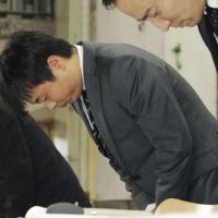 No one's laughing: Popular TV comedian Junichi Komoto bows in apology during a news conference Friday in Tokyo. | KYODO