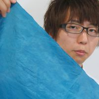 Material advantage: A man on Monday holds up a sample of cesium-adsorbent cloth developed by the University of Tokyo's Institute of Industrial Science. | KYODO