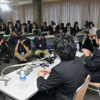 No easy answers:  Two men who served as lay judges in a complicated Saitama District Court murder trial face reporters after they and their fellow judges sentenced the defendant to death. | KYODO