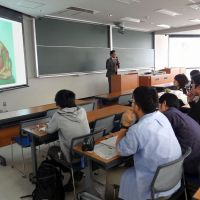 Life lesson: Associate professor Toshiyuki Tachikake, displaying a photo of Aum Shinrikyo founder Shoko Asahara, lectures first-year students about the dangers of cults during a class at Osaka University in Toyonaka on May 12. | KYODO