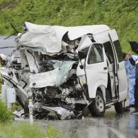 Twisted mass: Officials inspect a shattered van involved in a head-on collision with a truck that killed five people Saturday near Nihonmatsu, Fukushima Prefecture. | KYODO