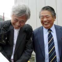 Finale near: Lawyers Hiroshi Kamiyama (left) and Shozaburo Ishida share smiles Wednesday after meeting with their client, Govinda Prasad Mainali, at the Yokohama Office of the Tokyo Regional Immigration Bureau. | KYODO