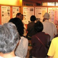 Domestic atrocity: Visitors view photos on wartime sex slavery in Okinawa at an exhibition Saturday at the Women's Active Museum on War and Peace in Shinjuku Ward, Tokyo. | KYODO