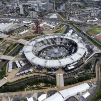 Global venue: London's Olympic stadium is calm July 13 before the opening ceremony for the games. People leave the stadium after finishing a rehearsal July 18. | KYODO