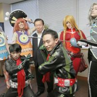 It's show time: Costume players from Britain, Russia and Indonesia who will attend the  World Cosplay Summit in Nagoya on Saturday get together with  Vice Foreign Minister Ryuji  Yamane (who was not wearing a special costume) at the Foreign Ministry on  Tuesday. | KYODO