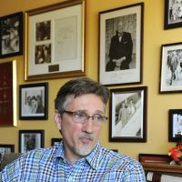 Soul-searching: Clifton Daniel, a grandson of U.S. President Harry Truman, is interviewed recently at his home in Chicago with photos of his grandfather on the wall behind him. | KYODO