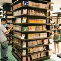 Summer reading: Visitors browse some of the 50,000 titles at a new manga museum in Kitakyushu on Friday. | KYODO