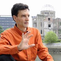Never forget: U.S. poet Arthur Binard speaks in an interview near the A-Bomb Dome in Hiroshima in June. | KYODO
