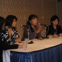Bosses: Managers (from left) Makiko Eda of Intel Asia Pacific, Nahoko Shindo of the World Health Organization and Riwa Sakamoto of the Ministry of Economy, Trade and Industry engage in a panel discussion. | HIROKO NAKATA