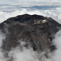 Disaster in the making?: Mount Fuji pierces the clouds on Aug. 4. | CHUNICHI SHIMBUN