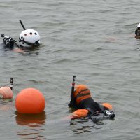 A dive in the dark: Coast guard divers search for the remains of victims of the March 2011 earthquake and tsunami off the coast of Natori in Miyagi Prefecture on Saturday. | KYODO