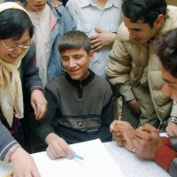 Taking shape: Mayumi Karako (left), a housewife from Ikoma, Nara Prefecture, teaches a visually impaired boy how to draw a picture at an orphanage in Herat, Afghanistan, in 2006.   KYODO
