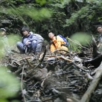 Lost and found: Students from Uenomiya Junior High School in Osaka descend a mountain in the village of Yoshino, Nara Prefecture, Tuesday after they were stranded overnight. | KYODO