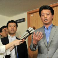 Temperatures rising: Foreign Minister Koichiro Genba speaks to reporters at the ministry Friday.   AFP-JIJI