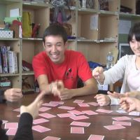 Alternative learning: Students play cards at the Tokyo Shure free school in Kita Ward last year. Below: Yuki Ujiie, who stopped attending a public junior high school because of bullying, is interviewed July 26.   TOKYO SHURE