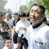 Curve ball: Hirokazu Iwashima, coach of the Sakushin Gakuin High School baseball team, faces the media Saturday in Nishinomiya, Hyogo Prefecture, after one of his players was arrested. | KYODO