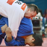 For the count: Japanese judoka Daiki Kamikawa (below) grapples with Iha Makau of Belarus on Aug. 3 in London. Daiki lost the 100-kg class match, which left the Japanese male judo team bereft of Olympic golds for the first time since the sport was introduced at the 1964 Games in Tokyo. | KYODO