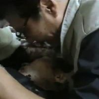 Casualty of war: An image grab taken from a video uploaded Tuesday to the video-sharing site YouTube shows Japanese journalist Kazutaka Sato mourning over the body of his colleague and common-law wife, Mika Yamamoto, who was shot dead Monday while working in the northern Syrian city of Aleppo.   AFP/YOUTUBE