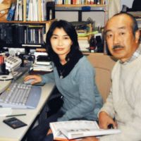 Cut down: Journalist Mika Yamamoto, who was shot dead Monday in Syria, poses for a photo with her father, Koji, at their home in Tsuru, Yamanashi Prefecture, in February 2005. | KYODO/YAMAMOTO FAMILY