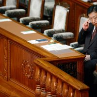 It's lonely at the top: Prime Minister  Yoshihiko Noda sits in his seat in the Lower House on Friday. | AFP-JIJI