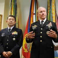 Top brass: Chairman of the U.S. Joint Chiefs of Staff Gen. Martin Dempsey speaks to the media Thursday in Washington as his Self-Defense Forces counterpart, Gen. Shigeru Iwasaki, looks on. | KYODO