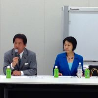 Matters of life and death:  Teruhiko Mashiko, a member of the Democratic Party of Japan and chairman of a nonpartisan group discussing death with dignity, talks about legislation to protect the rights of terminally ill patients, as the group's director,  Toshiko Abe of the Liberal Democratic Party, looks on during a gathering July 31 in Chiyoda Ward,  Tokyo. | NATSUKO FUKUE